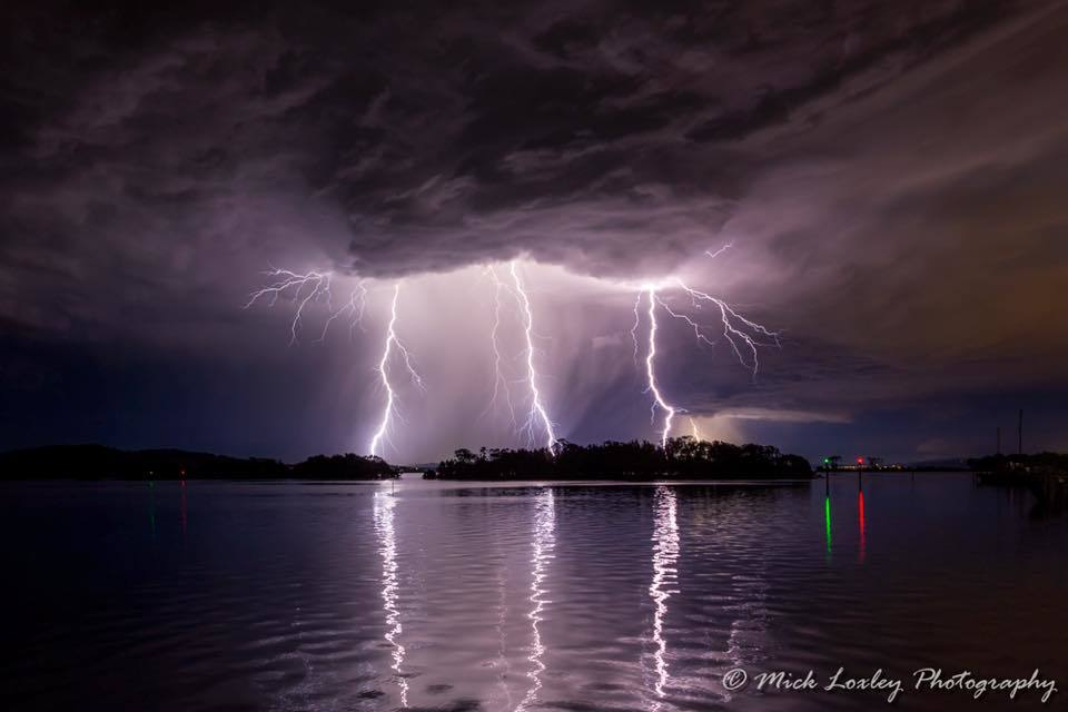 """Triple Treat"" A small but very lightning active cell swept over Newcastle Australia last night and I managed to snare these 3 bolts in a 28 second exposure"