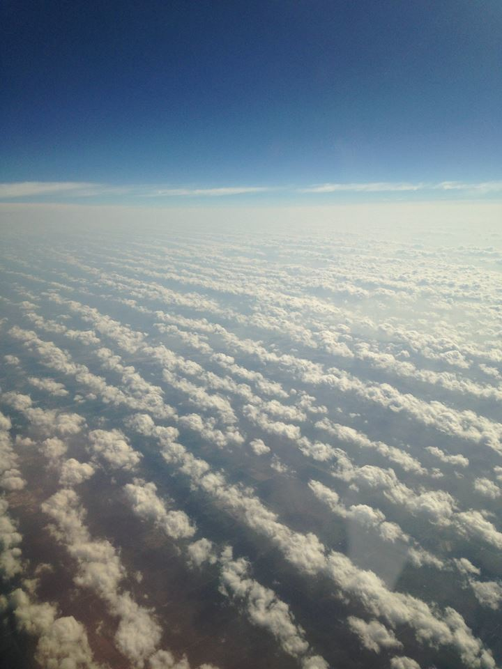 Taken on June 2014 from 30,000 feet in the air. I was approaching McAllen, TX. I love how these clouds are linear.