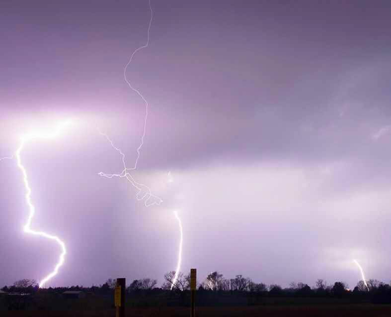 A two image stack of CG Lightning strikes just south of Joplin Missouri looking north. Taken: 04/02/2015