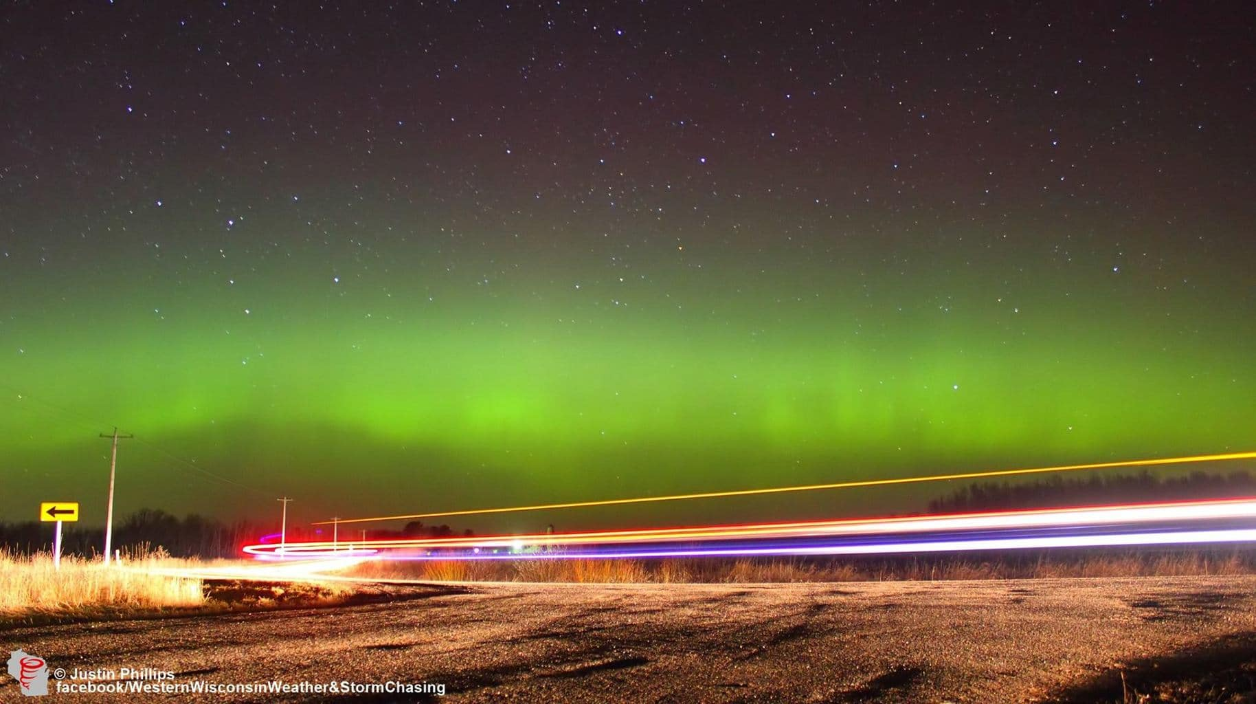 Northern lights and a passing car last night in New Auburn, Wisconsin.