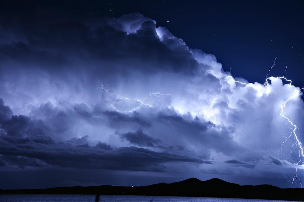 Huge Cumulonibus with positive lightning photographed from a distance of some 70 kilometers.  11/19/2014. Vransko jezero/Croatia.