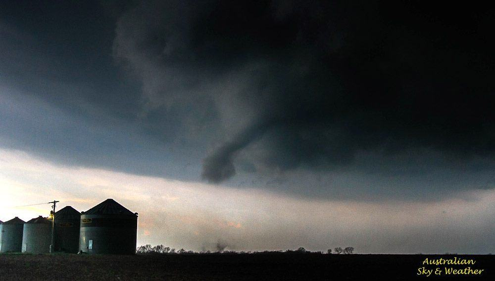 ...we were in SE Kansas and we watched a large cumulus become a tornadic supercell in the space of an hour..here the tornado touches down briefly near the town of Altamont. 2nd April 2015 Photo: Clyve Herbert / Jane ONeill