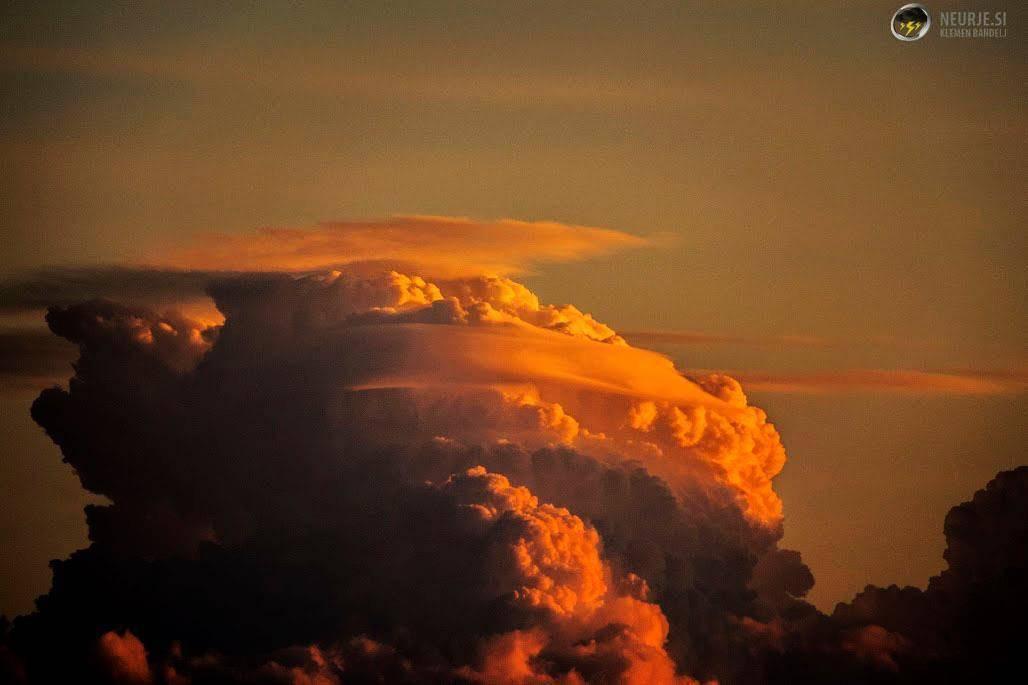 Sun illuminates cumulus cloud just before the sunset.