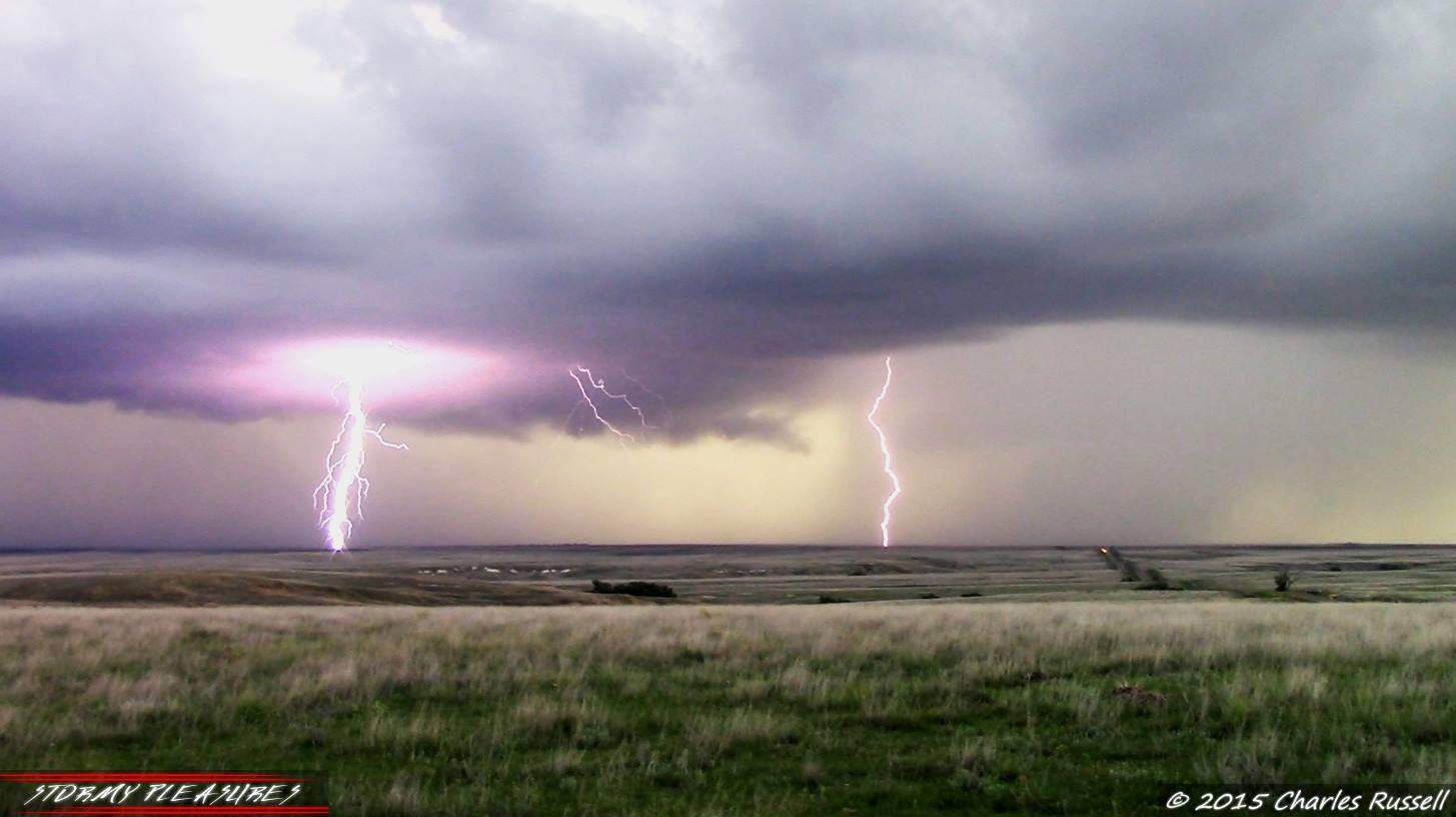 2 video screenshot composite of lightning strikes underneath a supercell in Kansas 5/9/15. Beauty of a storm!