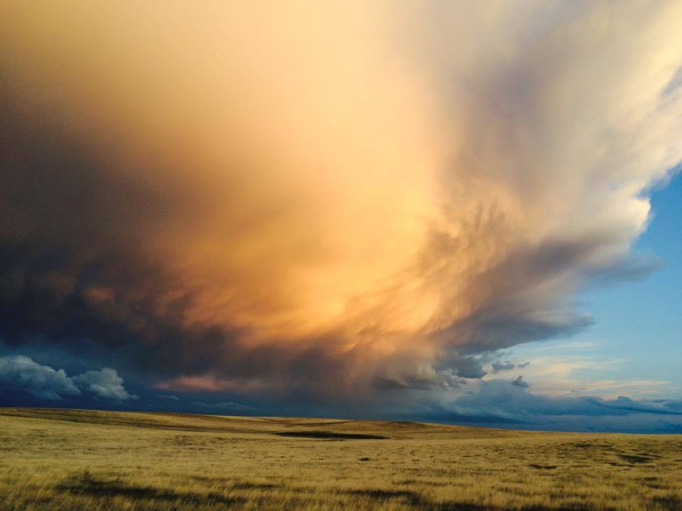 Caught the back end of this storm during magic hour near Schriever Air Force Base in Colorado. No filter needed, Mother Nature did this all on her own.