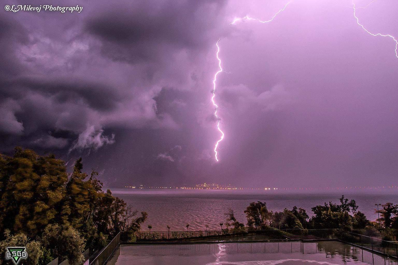 Lightning above Navene Lake Garda Italy last year 14.7.2014