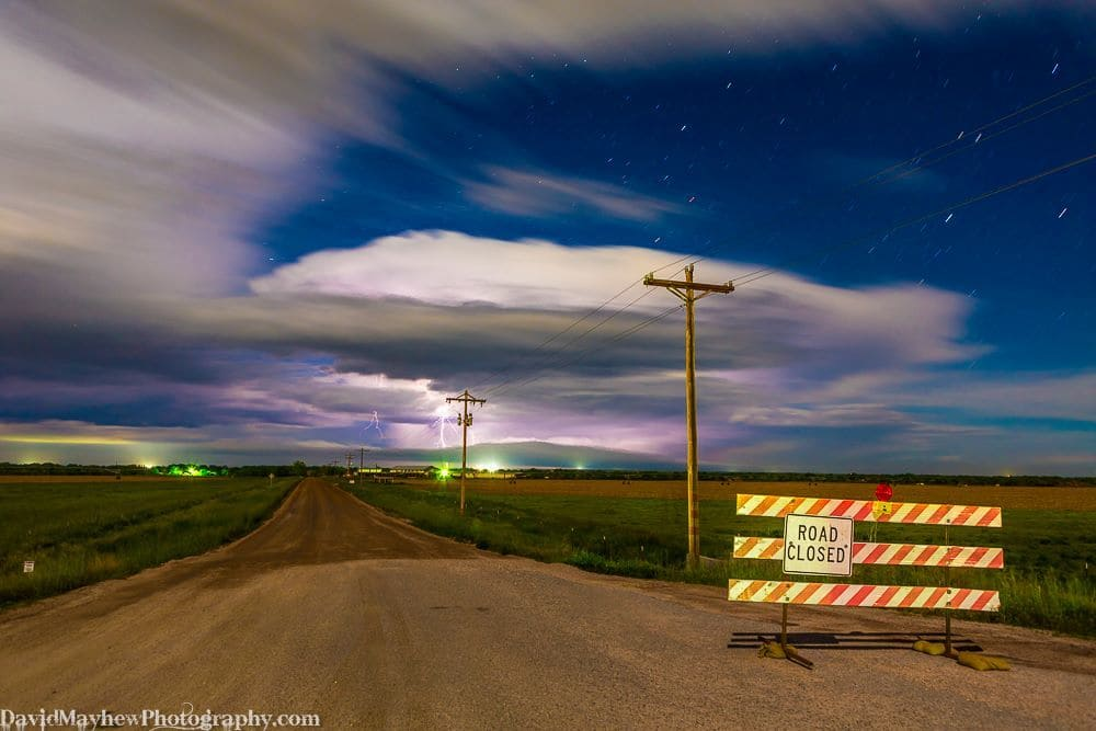 Although I did not have much luck with storms at the Nebraska/Colorado border I did get some nice lightning on the way home. I was hoping to get to the reservoir for reflections but the sign sums up chasing conditions this year! Near Wiggins CO