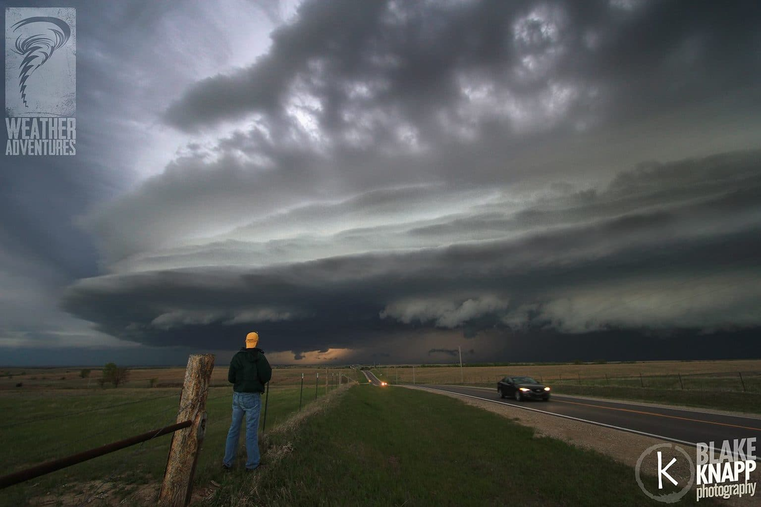 One of our chase tour guests (and friends) watches a storm rake across the Kansas countryside on April 24th