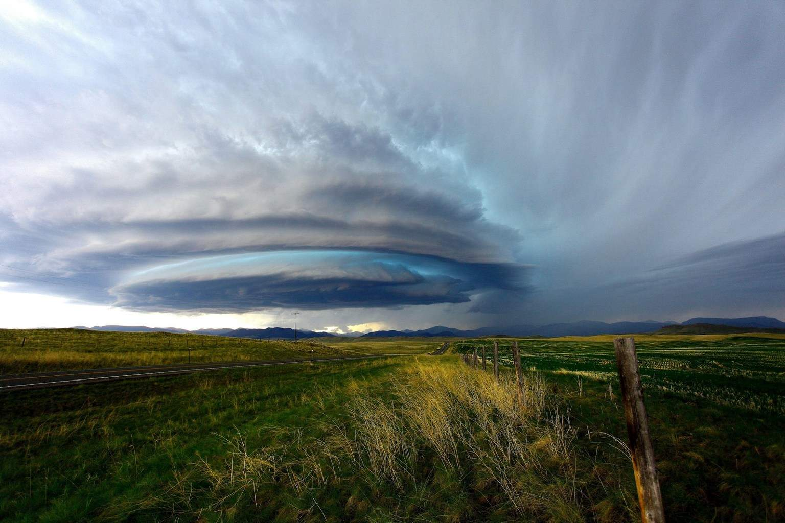 A throwback to one of my all time favorite's, June 4th 2012, SW of Fort Shaw Montana. We watched this storm come off the mountains early in the day, with each passing minute the storm became more amazing, morphing from a disc/saucer to stacked plates, till eventually getting visual on a low wall cloud. The storm maintained amazing structure for about 3 hours, producing very large hail at some points.