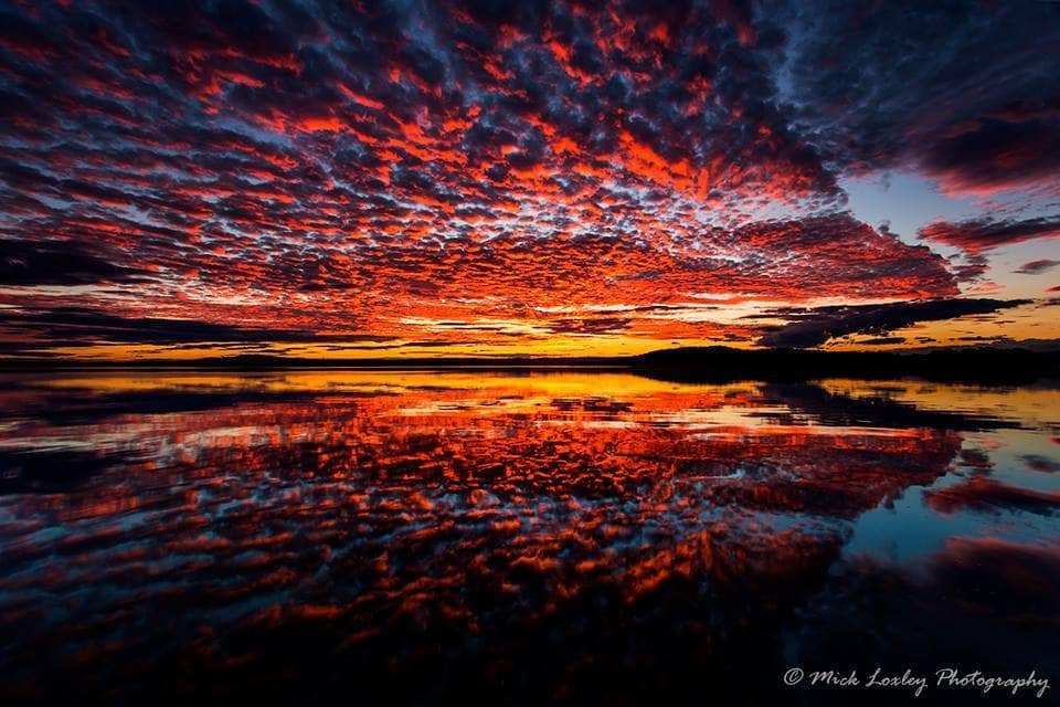 """""""Dreamtime"""" Calm waters made for a gorgeous sunset reflection over Lake Macquarie last Friday evening. Legend has it that the Aboriginal people watched the lake fill with water some 6000 years ago, and I felt that the title """"Dreamtime"""" was very fitting for this image. Taken at Swansea Jetty, Newcastle Australia."""