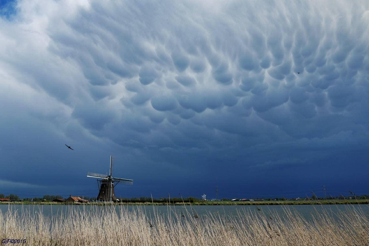 Here for the Mammatus lovers and other sky fanatics, a photo from a couple of weeks ago. Taken in the Netherlands (Europe) when a huge thunderstorm passes by.