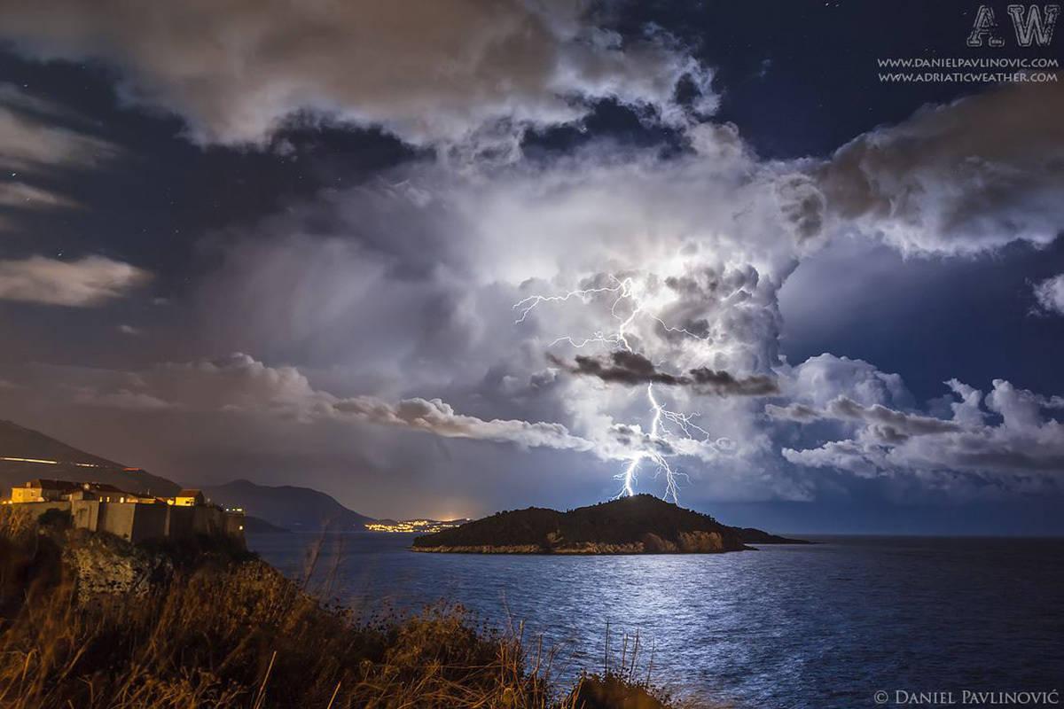 Beautiful isolated cumulonimbus with positive lightnings, photographed from Dubrovnik, Croatia, 17 Dec 2014.