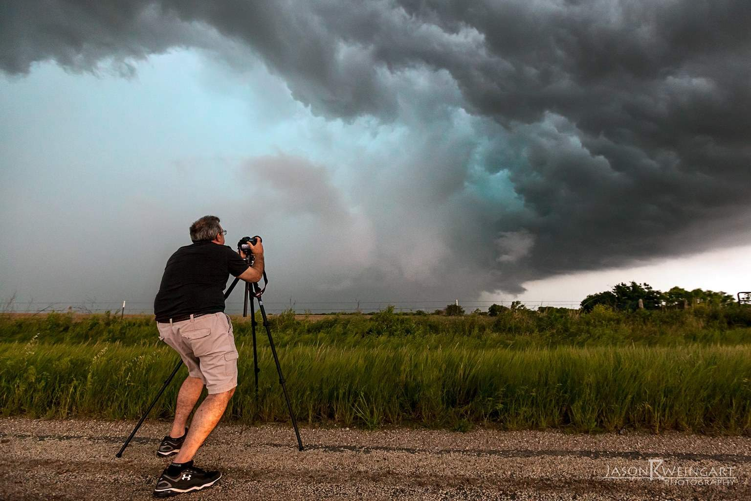Sometimes I find it interesting to step back and photograph the chasers that are documenting the storm. I took this image of Gary Schmitt photographing a mean hail core in Throckmorton, Texas on Friday.