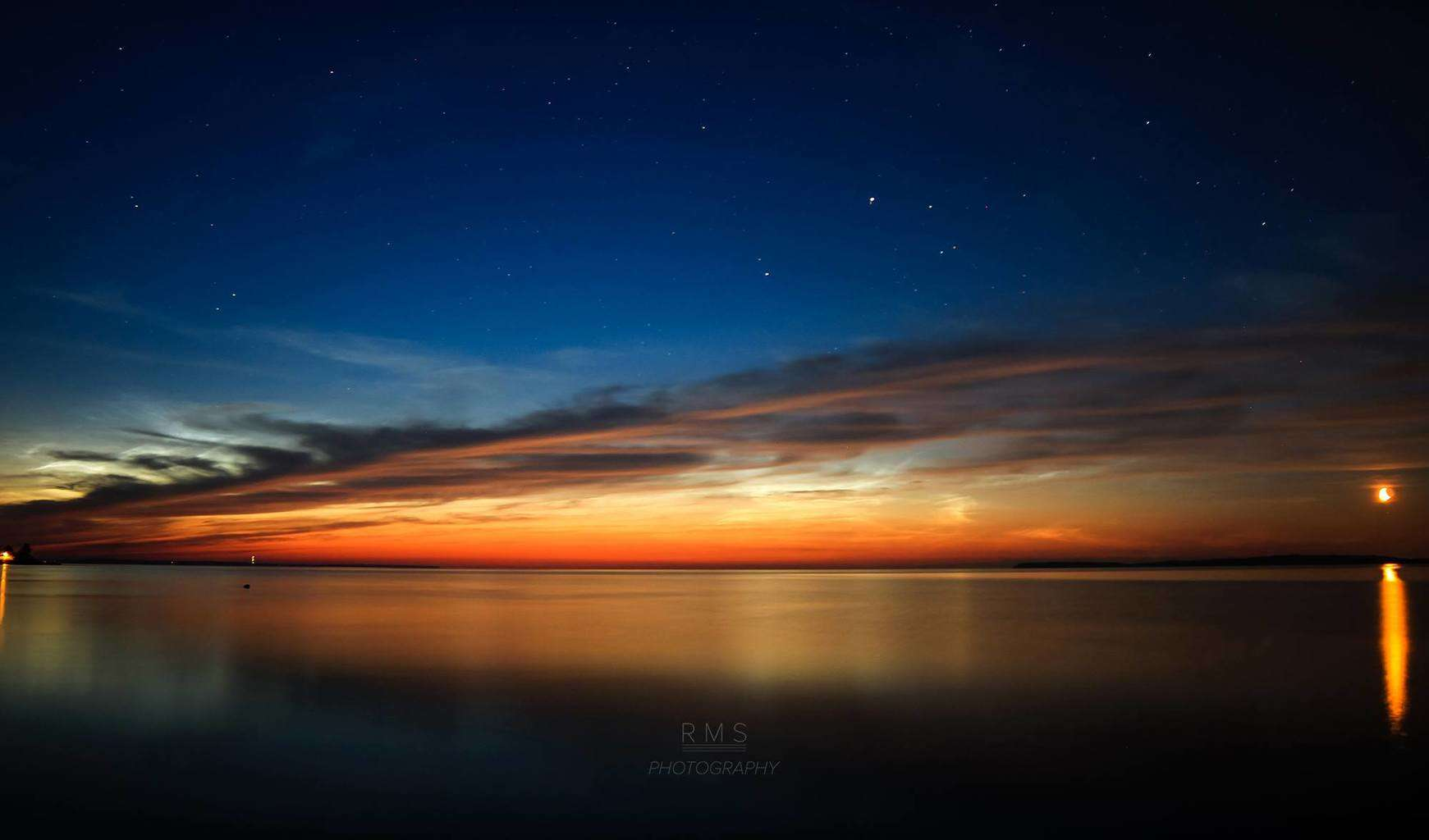 Summer nights are just around the corner! Noctilucent clouds and Moonrise above Limfjord, Denmark. Taken in July, 2014.