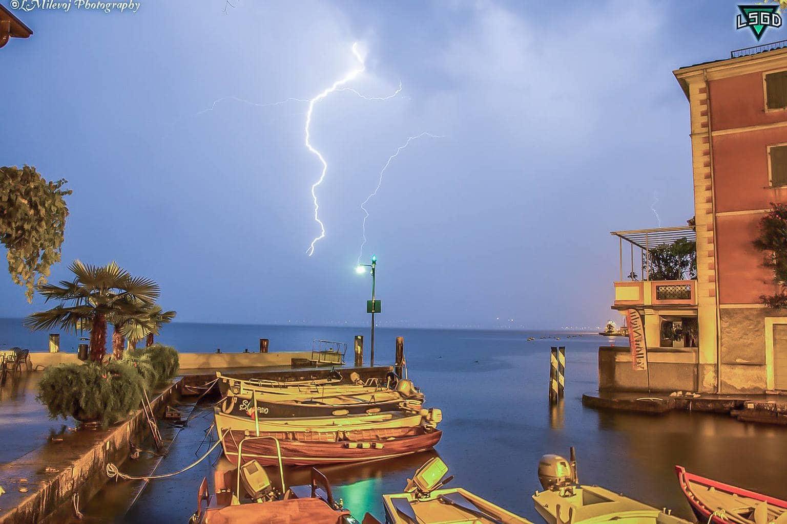 Quite port of Limone sul Garda and lightining (Lake Garda on 9 august 2014