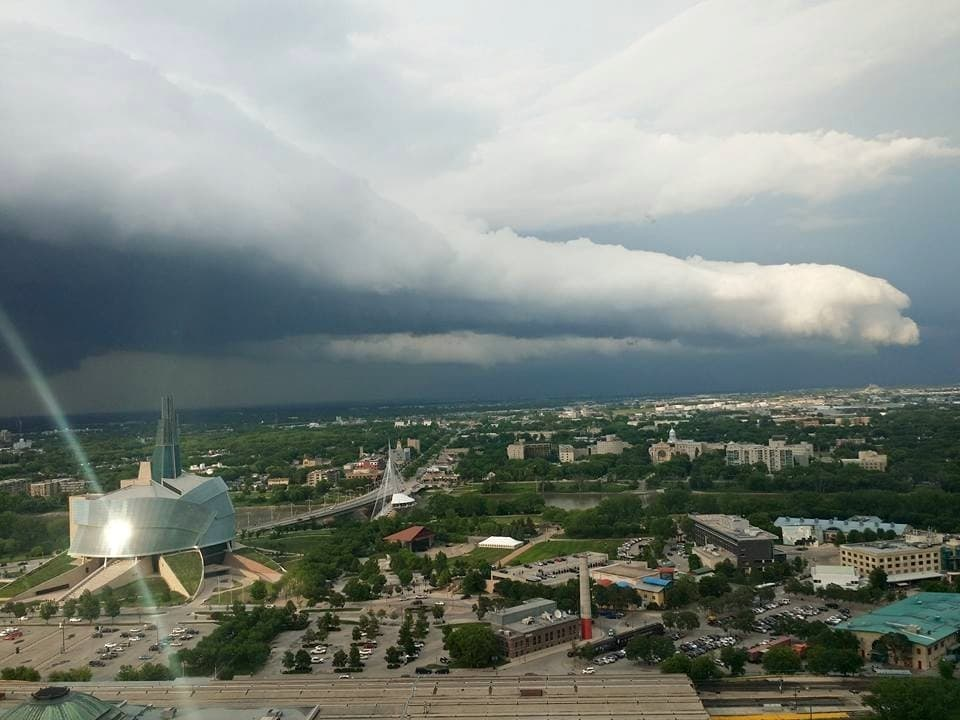 06/27/15 I was able to capture this storm from the revolving restaurant I work in, 30 stories up, as it came in from the north and seemed to hover over the Canadian Museum for Human Rights located in Winnipeg Manitoba, Canada . It was so surreal and looked like something out of a movie.