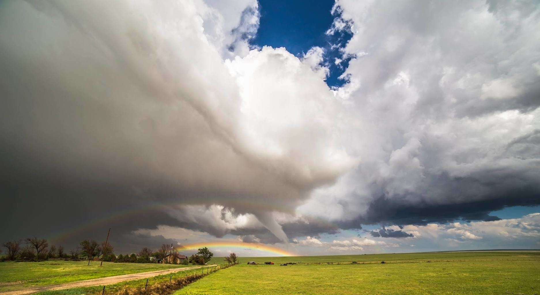 Difficult to write a description for this moment- Word's just don't seem to do this tornado and the scenery justice.  My view of the double rainbow framed front-lit tornado near Eads Colorado 5-9-2015, the first this cyclic LP supercell would produce of a handful. This is one of the most amazing things that's ever happened to me, I wish one of these days to every storm chaser and weather enthusiast sometime in their lives.  It's taken quite a bit of willpower to hold off on posting this here haha, hopefully makes it that much sweeter