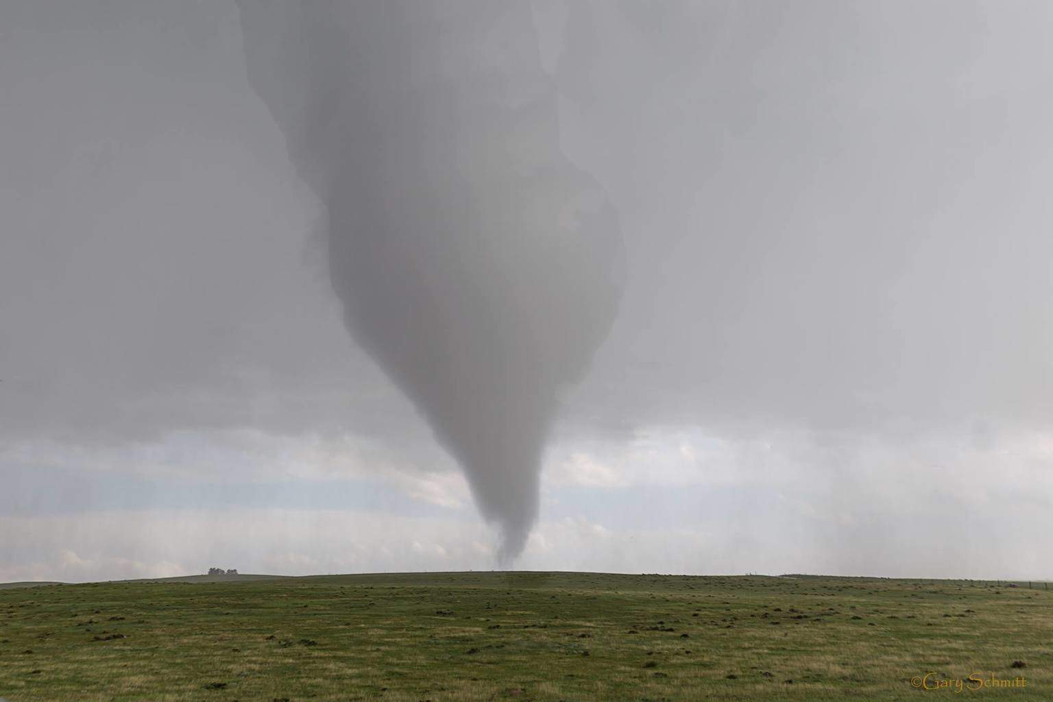 This shot is the Simla tornado right after it crossed the road .