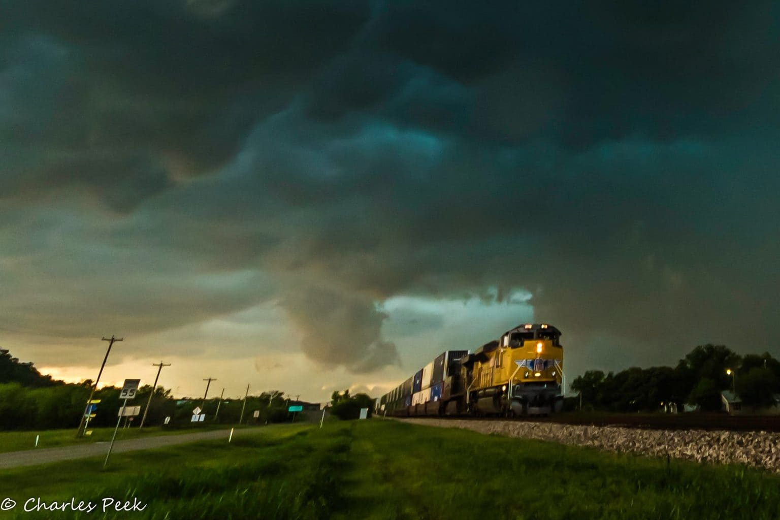 I had to stop and get a picture of this train as we were racing through Gordon,TX to stay ahead of a Tornado warned storm. With a Tornado just 3 miles behind us I didn't have time to get a good set up on this shot but got lucky and it turned out pretty good.