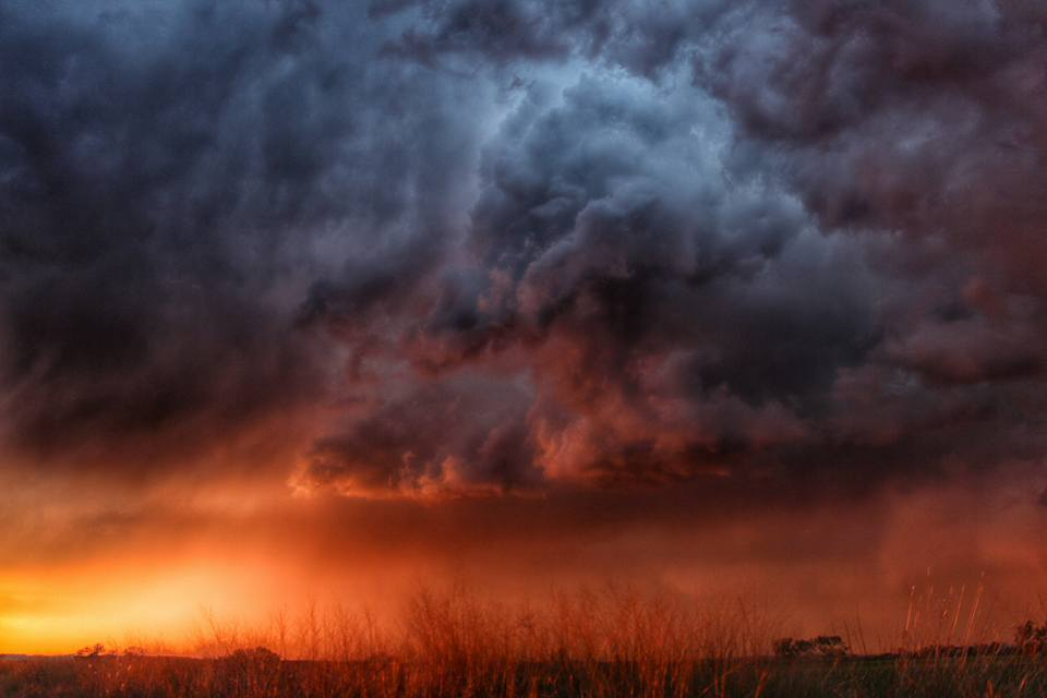 Sun sets the sky on fire as a dying storm crosses the border from Mexico into far south Texas last November