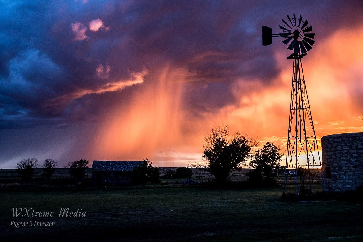 Farmyard sunset as a weak evening thunderstorm moves across the prairies of western Kansas in Hodgeman County. May 29, 2015