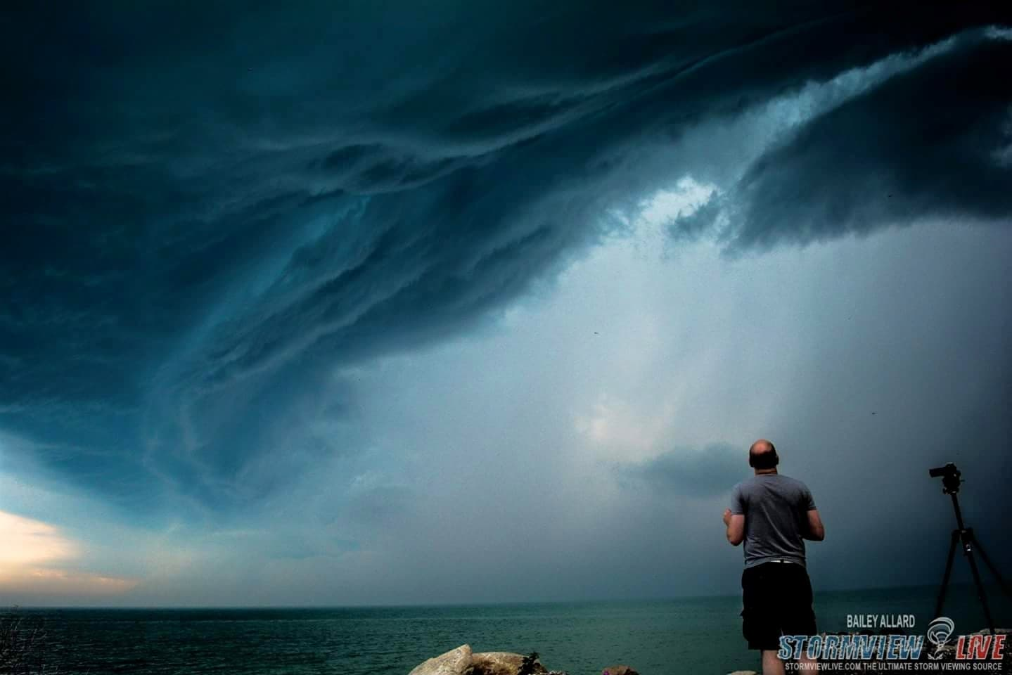 Dave Patrick in awe as the storms move into Ontario over Lake Huron. June 18th, 2015. Taken at Point Clarke.
