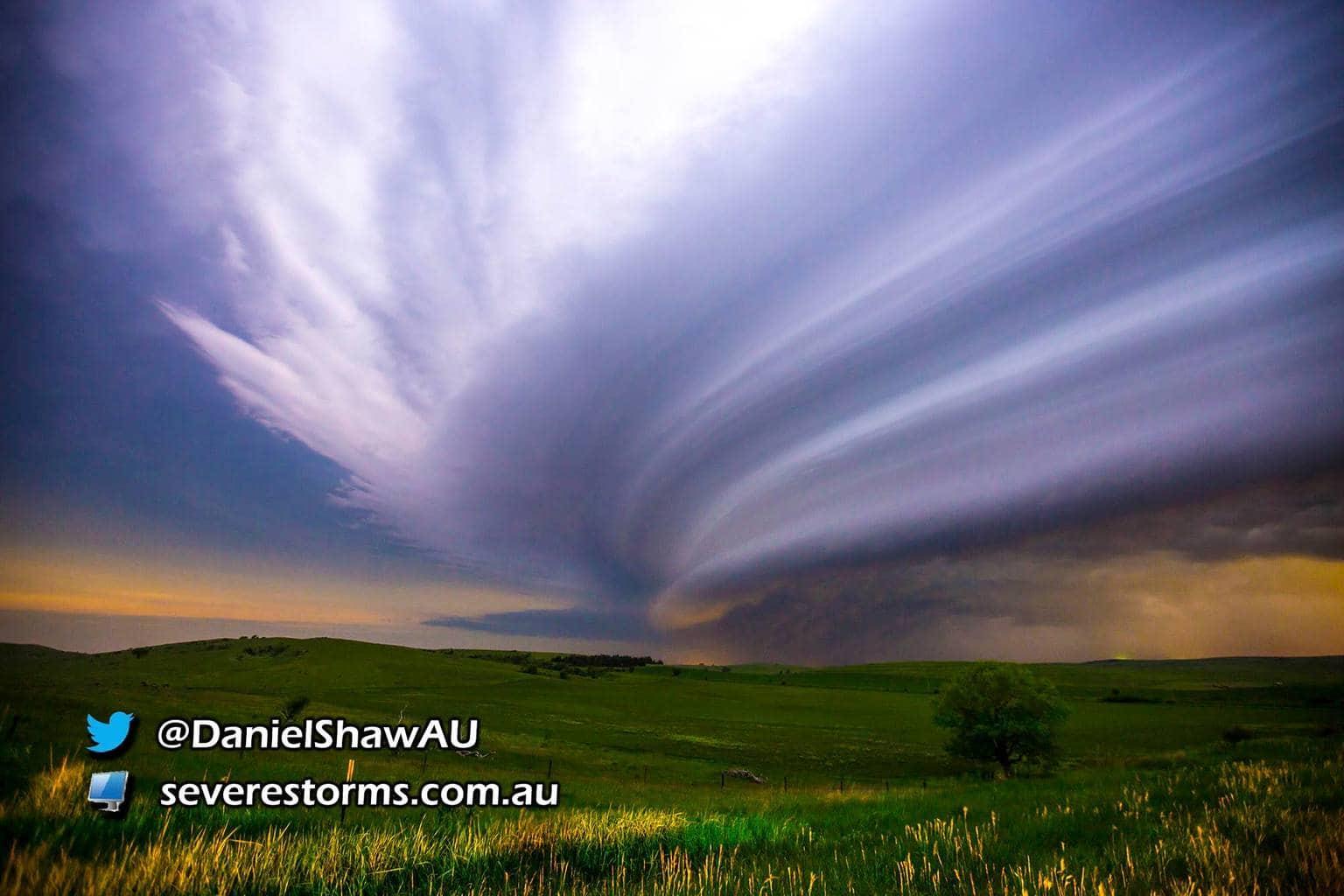 12.30am, Near Broken Bow, Nebraska. A severe storm lights up the night sky, revealing the farmland below. Striated squall line dominates the frame.