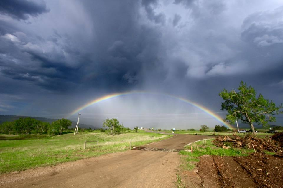 My first post, a beautiful rainbow near Rapid City, SD on June 1 while chasing with ETT. Hope you all like it!