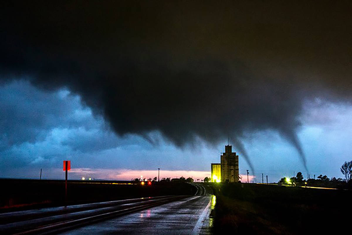 Lightning illuminates two slender tornadoes dancing in front of us in the hook region of the supercell near Page City, Kansas on the night of June 5 2015. Soon a large tornado will form from the wall cloud. We encountered 8 tornadoes in the hook on this night