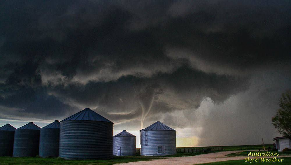 There's nothing like having a good prop and a tornado in the background...this is one of those images where you pass a prop on the road and you snap a picture and it turns into magic! This is the Matheson-Simla anticyclonic tornado spinning behind grain silos. 4th June 2015