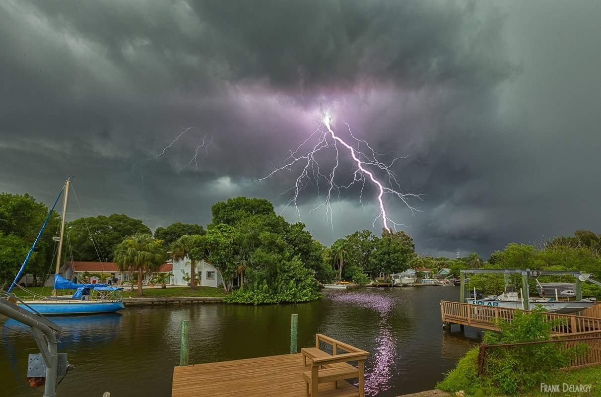 Watching the storm and lightning pass through from the porch. — in Tampa, Florida.