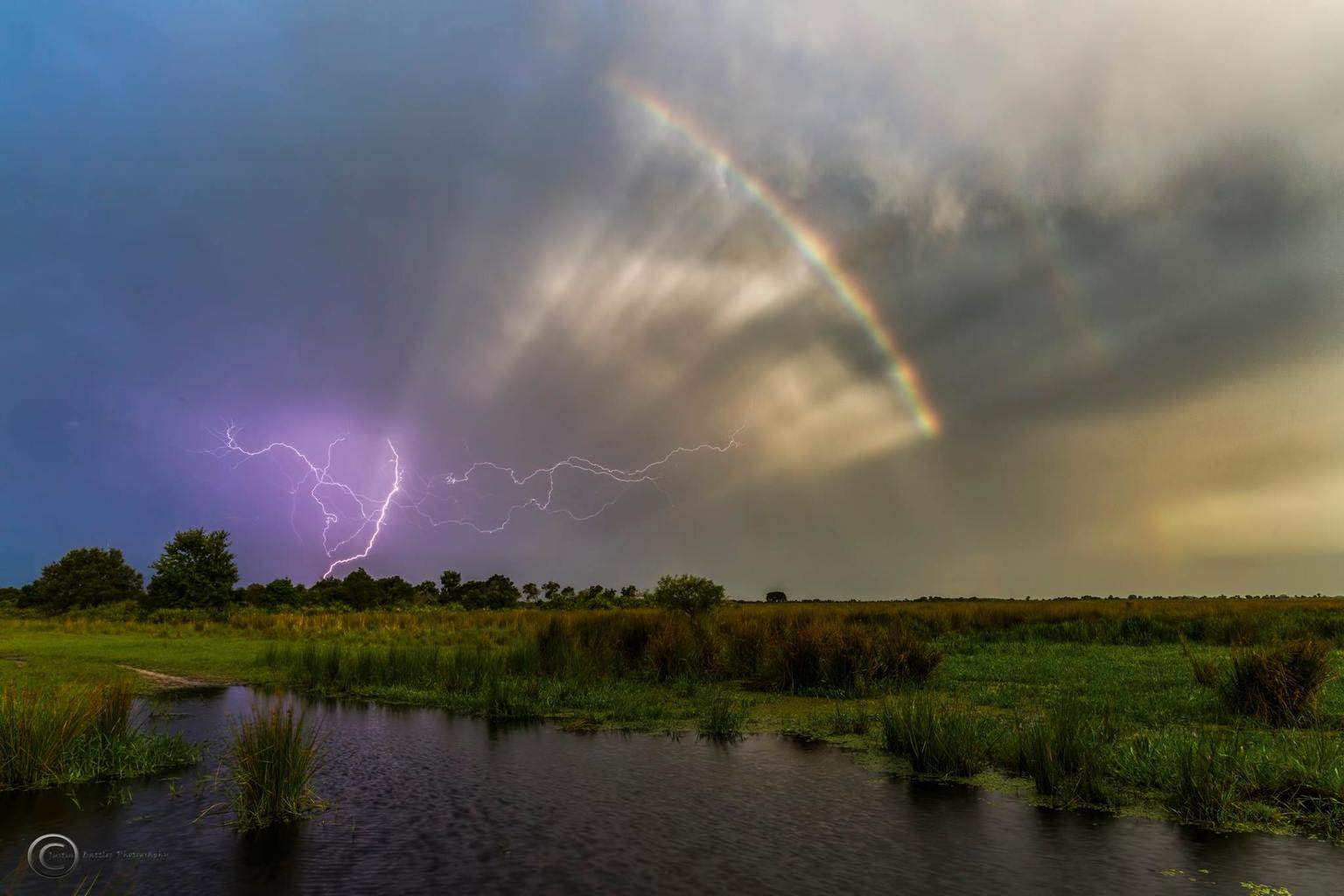 Lightning and a rainbow this afternoon in Arcadia, Florida