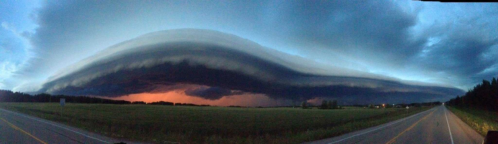 Pano of shelf cloud that swept across west central Alberta, Canada last night. Such a beautiful sky!