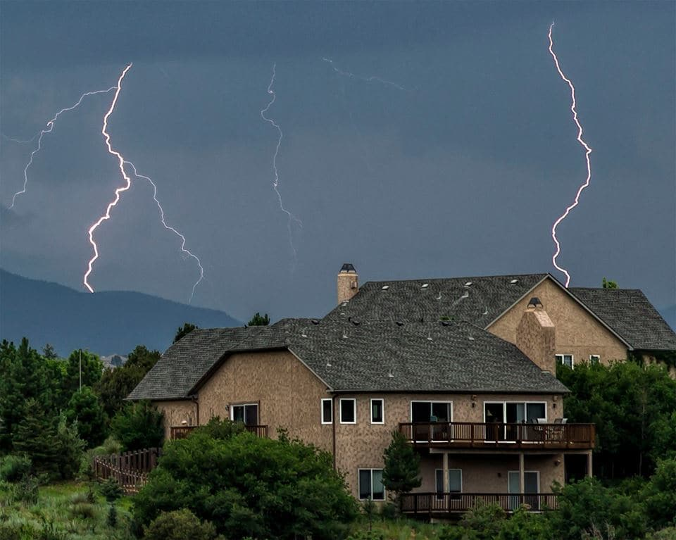 A double lightning bolt during the early stages of tonights storm on the north side Colorado Springs. single frame. 07/09/2015