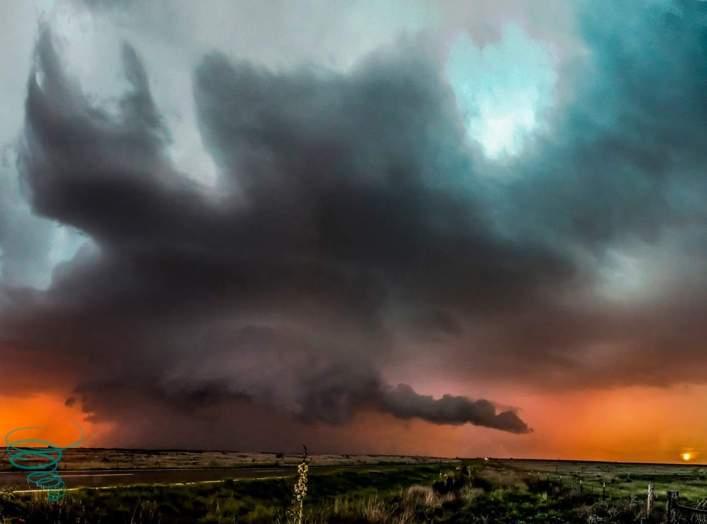 This supercell from Bluitt, New Mexico on May 29, 2015 was the storm that kept on giving. After producing a picturesque tornado, it, in tandem with the approaching sunset, produced a wonderful display of color. The addition of sporadic lightning added even more color to the view.