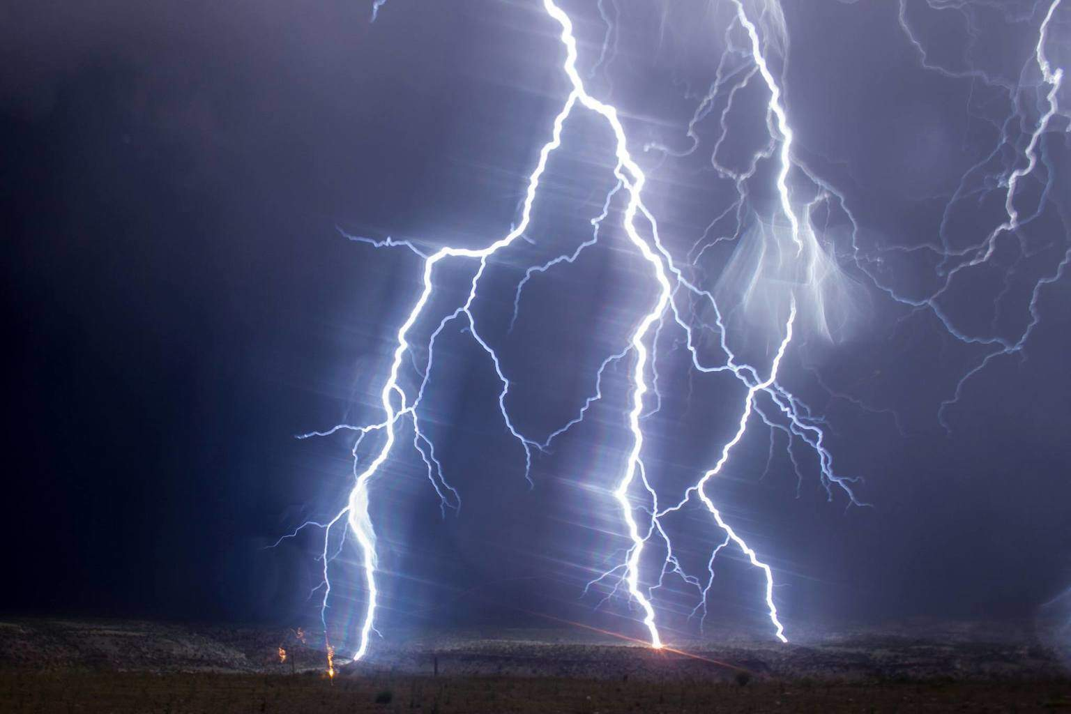 A little something from last night's electrical storm over Grand Junction, Colorado through the rainy car window. You know, when you think maybe the next strike might be too close?