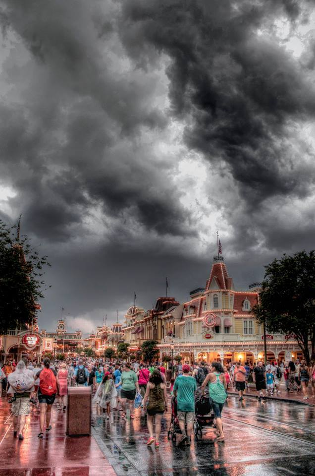 "I took this HDR shot while visiting ""The Happiest Place on Earth""....Disneyworld, Florida. Somehow, we managed to visit the week of the most continuous heavy thunderstorms they had ever seen. We didn't chase the storms...they chased us. But as you can see, hardly anyone paid attention. Now that's surreal....and that's magic!"