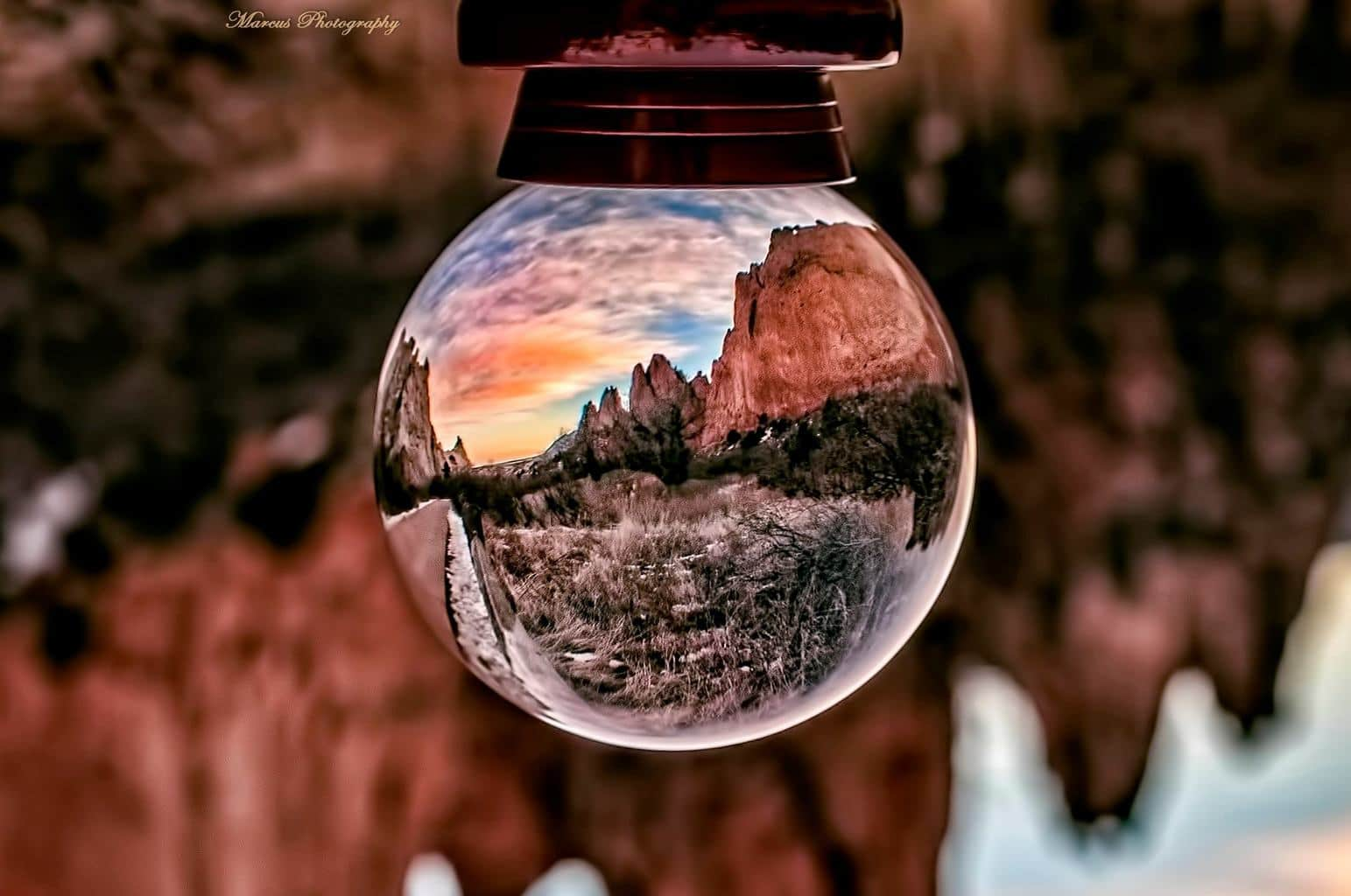 Colorful cloud sunset through a crystal ball taken in Garden of the Gods a little while back!