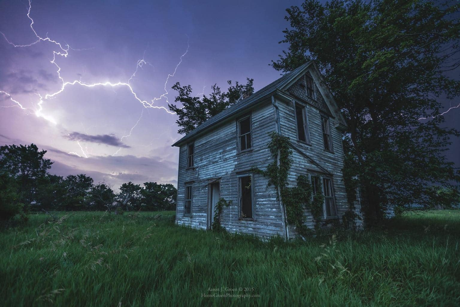 From a Series of Dark Places...  Lightning strikes right behind an abandoned old farm house. 10 second f/2.8 50iso Canon 6D and 16-35 L II  rural South Dakota
