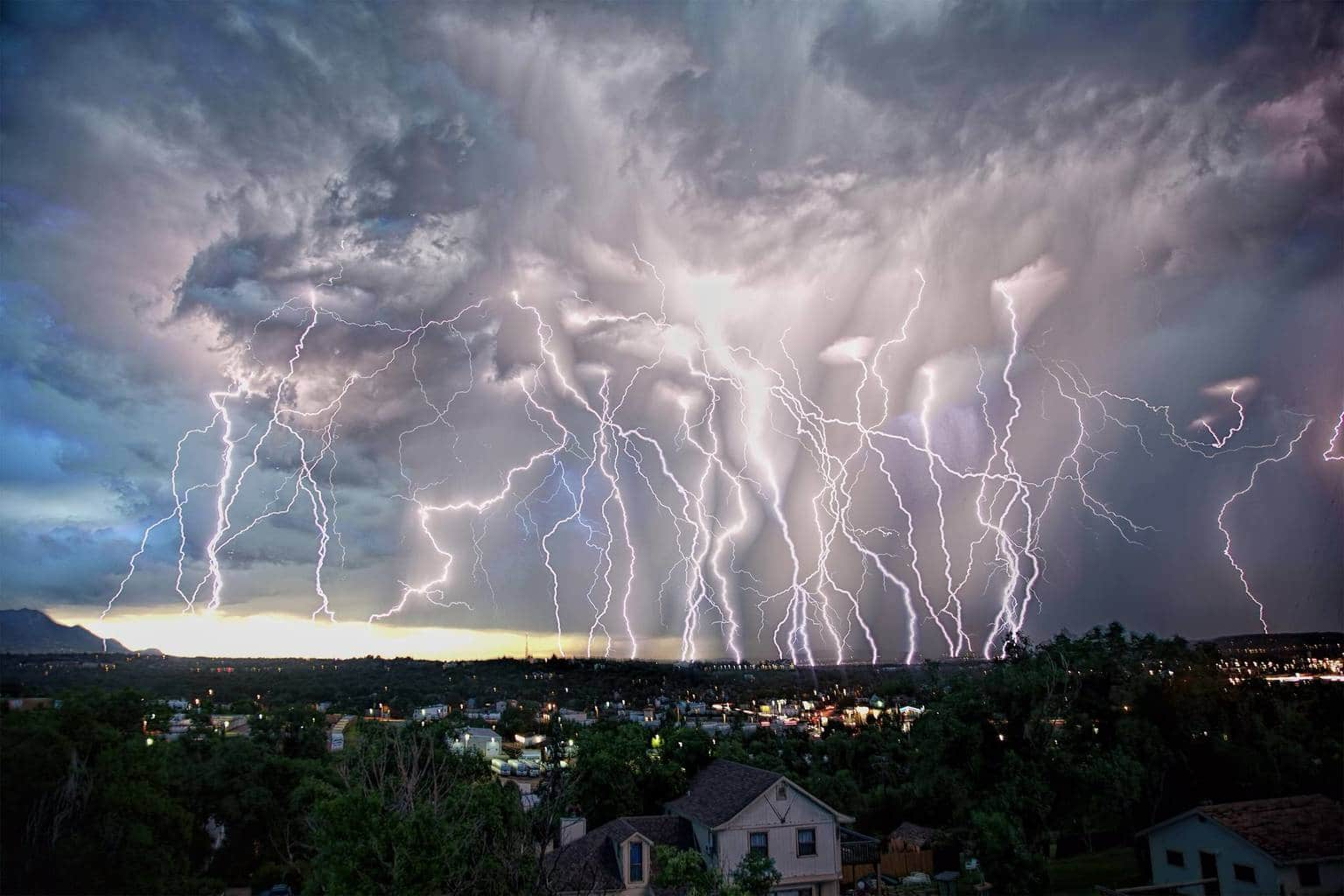 Tonight's storm was intense. I was able to put together this composite of lightning bolts before I was chased to cover. This was looking north from near downtown Colorado Springs. 06/28/2015