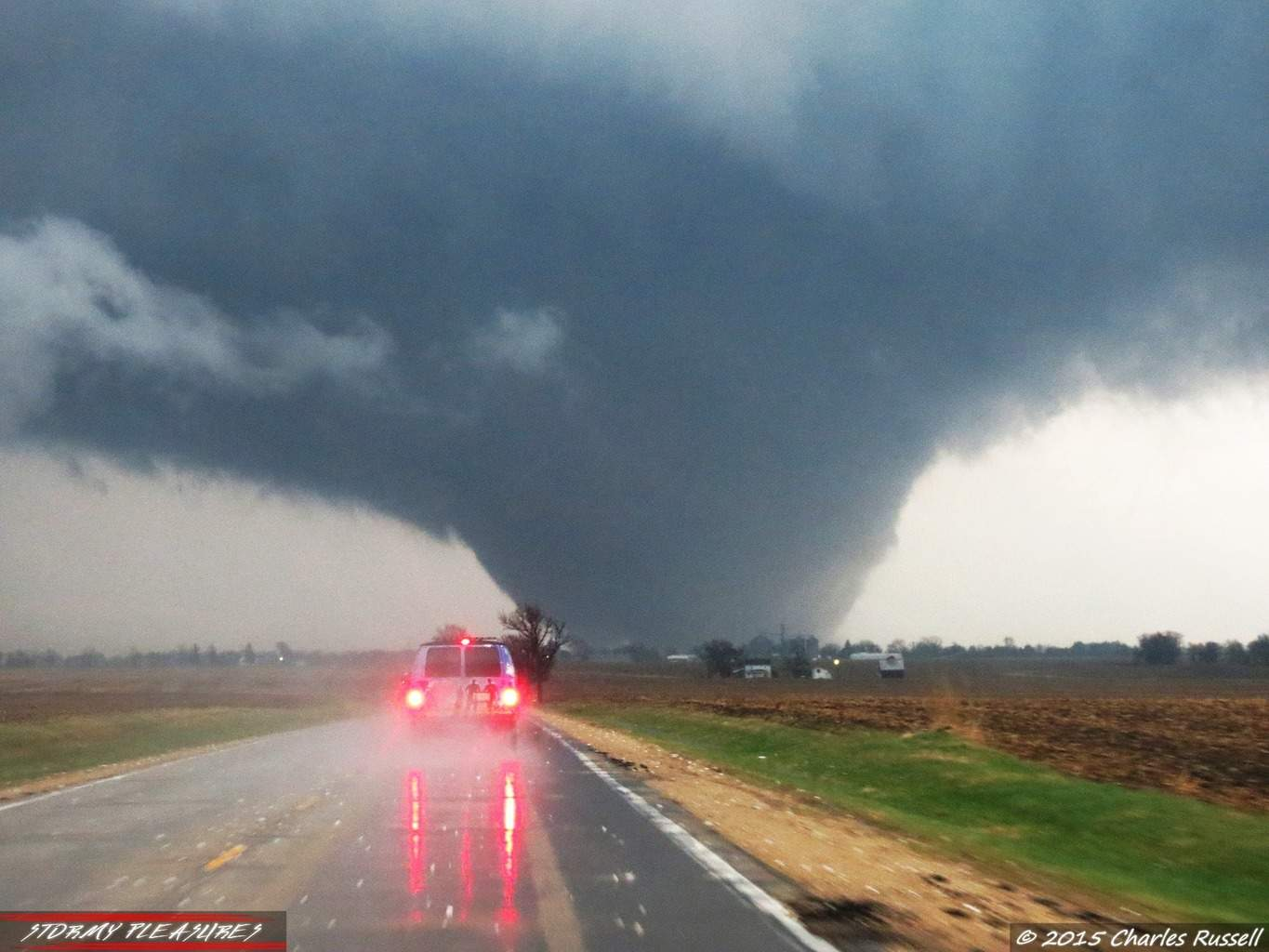 One of the most amazing and epic chase days of my whole life. Here my buddy CJ and I were behind Extreme Tornado Tours getting up close and personal with this EF-4 wedge tornado near Rochelle, IL on 4/9/15! This beast was amazing to watch through it's life. A massive wedge tornado certainly gets the adrenaline pumping!!
