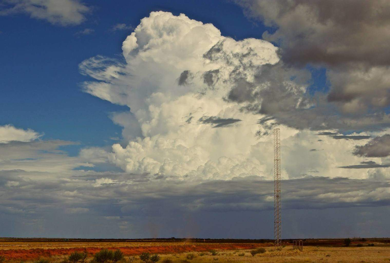 Building thunderstorm near Learmonth, Western Australia during the cyclone season earlier this year. Dust devils swirled up below & in front of it for hours. Lots of rumbles.