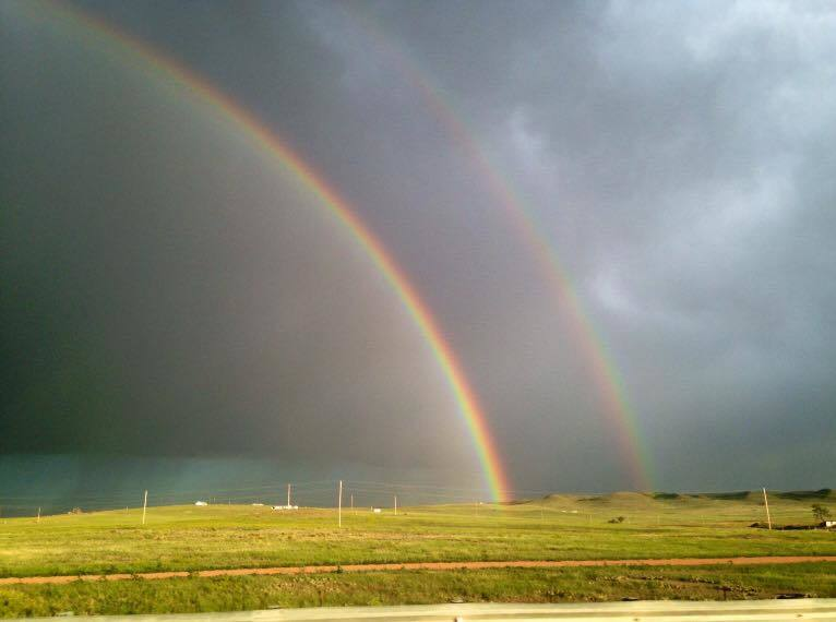 I had never seen a double rainbow and this close. Limon Colorado June 2014