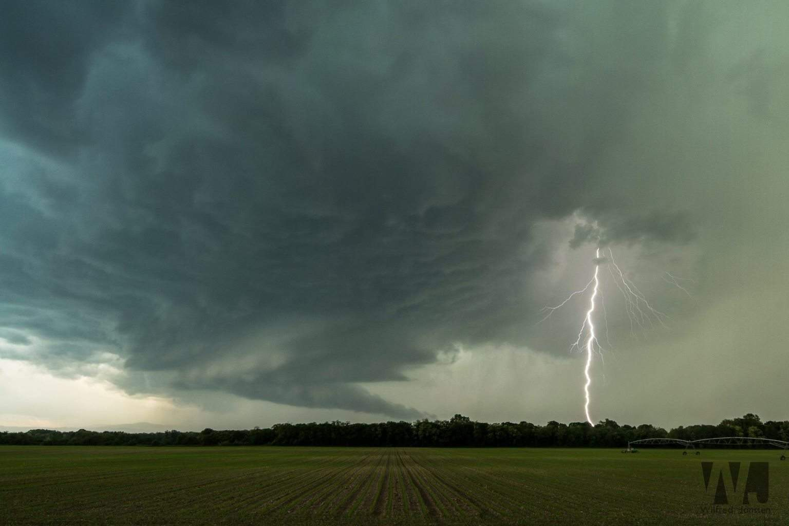 """Classic supercell thunderstorm near Freiburg (Germany) along the France/German border on May 13th 2015. This supercell managed to produce an EF-2 tornado about 15 miles east of us. We had to give up following this cell when we were trapped in its hail core with 1.5"""" hail. One of the best supercells I've ever captured while chasing in Western Europe!"""