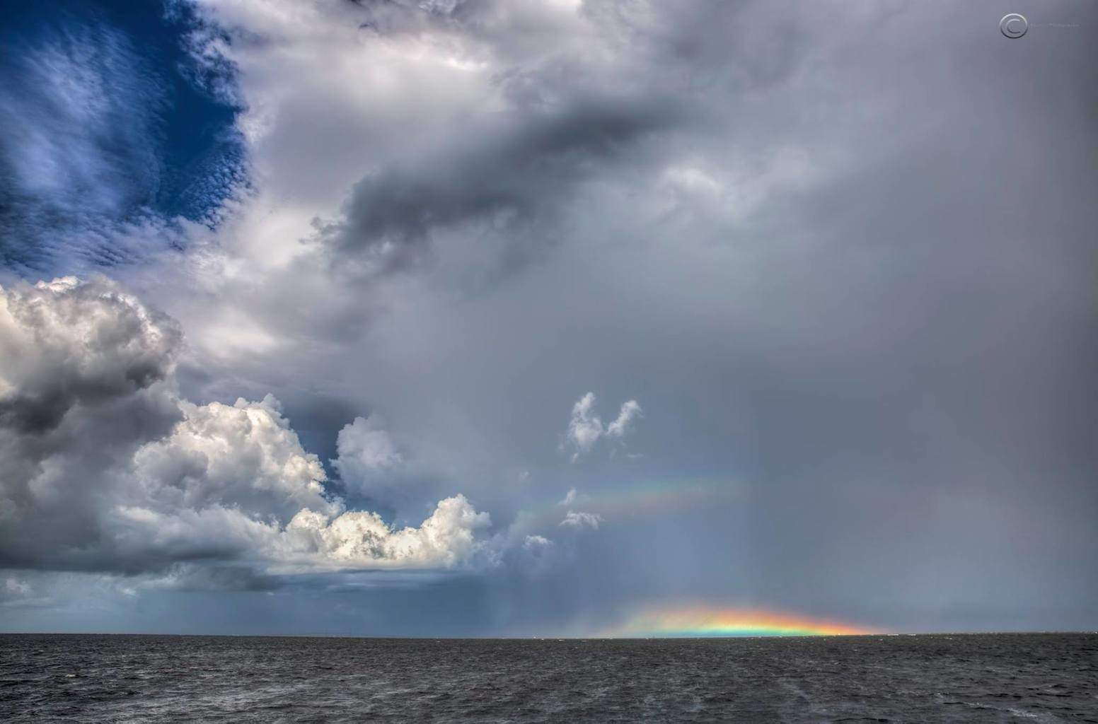 Double rainbow under a rapidly developing thunderstorm over Tampa bay, Fl this morning handheld shot from the bow of my rocking boat just before we headed back to the boat ramp, lol