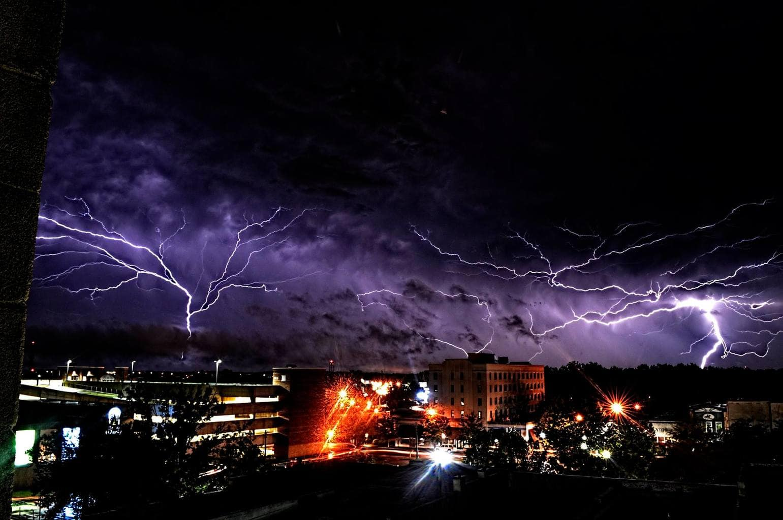 I took this shot from the fire escape of the building I live in here in Downtown Gainesville. Hope you like the shot. It's also entered in the Weather Channel's current photo contest. Was taken with a 15 second exposure, as soon as I pressed the remote shutter release this happened. I literally jumped into the air with excitement. Photography is my true passion, hope you enjoy my work. Thanks for having me.