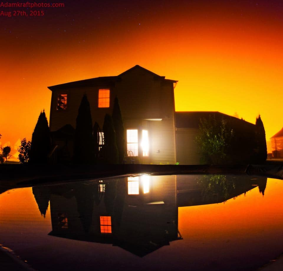 This is what you get at 4:30am when you think outside the box and use fog in the streetlights as a back drop to the house that you want to reflect in the water on the swimming pool cover. Pic taken in Spring Arbor MI in my back yard last night. I love the use of light, shadows and reflections.