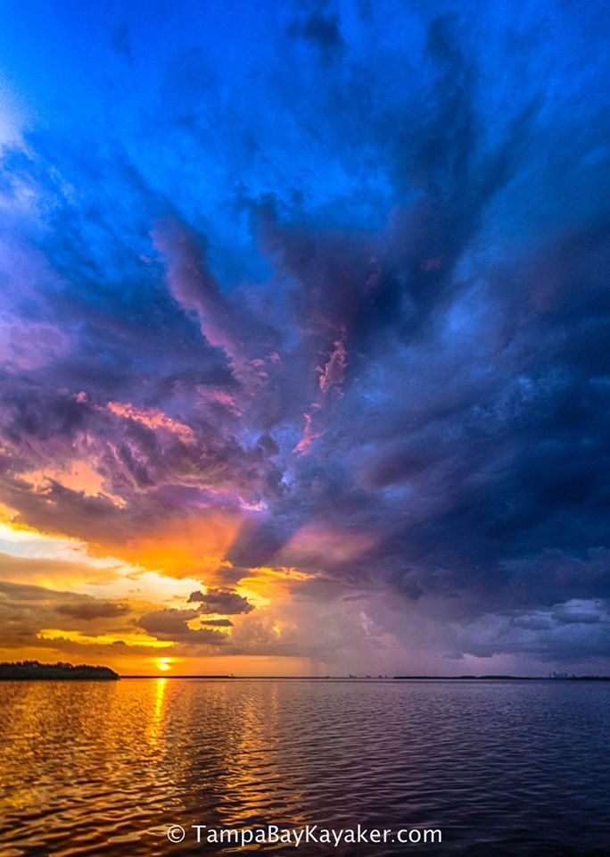 Thunderstorm, color and sunset with crepuscular rays - Tampa Florida