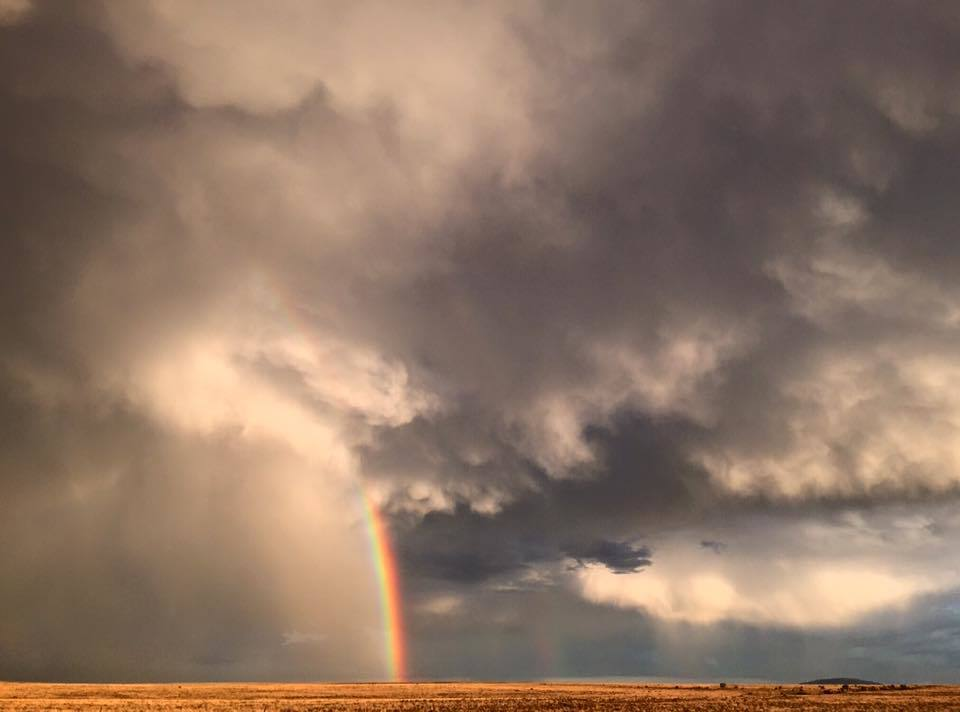 Dying storms and a Rainbow south of Winslow Arizona