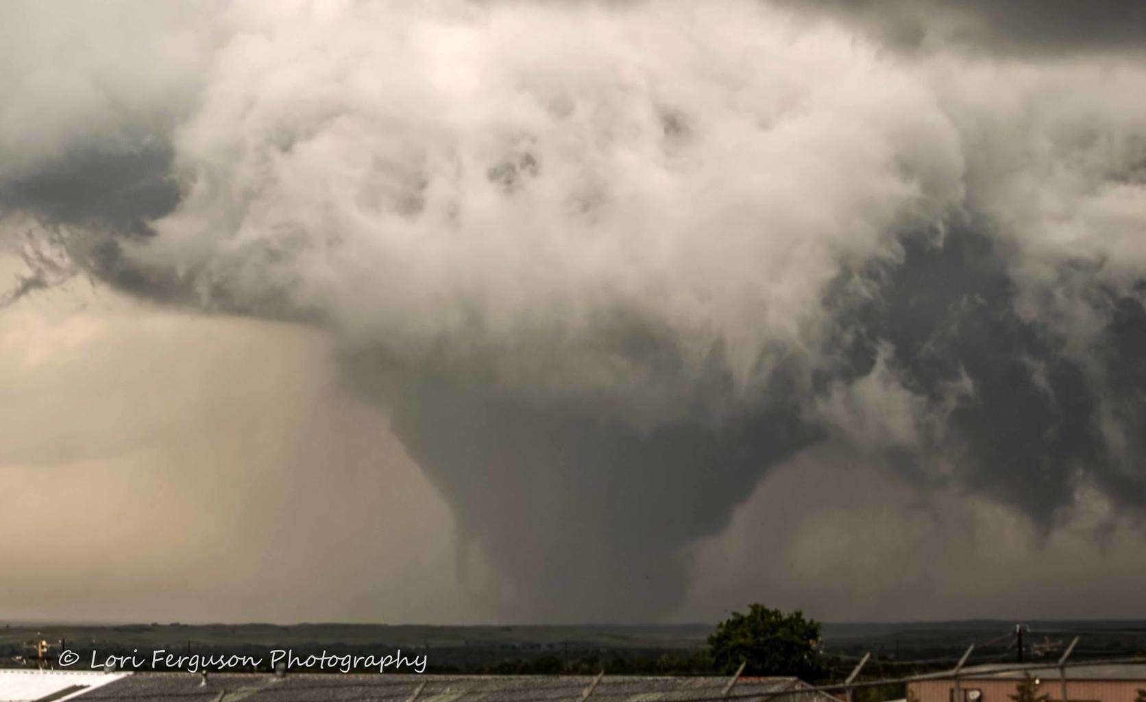 Another view of the May 27th Canadian, TX tornado. It was nearing the end of its cycle here, looking like a gigantic ice cream cone. And you can see a horizontal vortex on the left.